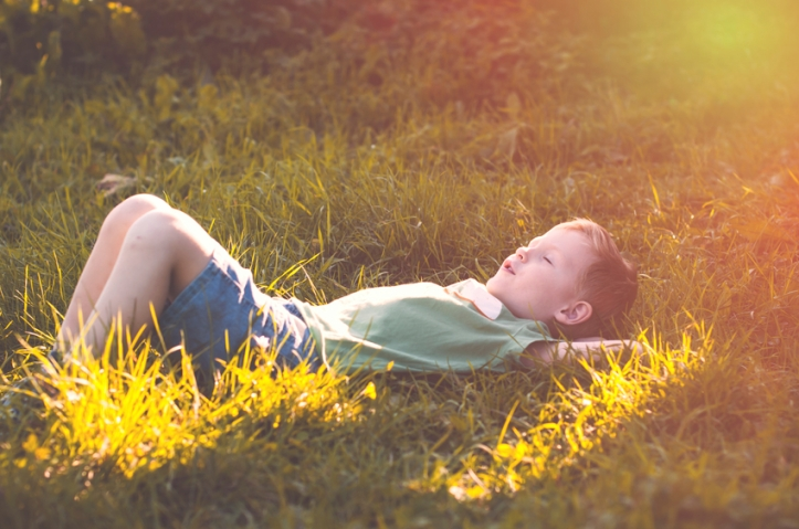 Child peacefully sleeps on nature